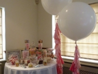 Candy buffet with jumbo balloons with tassels
