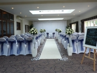 aisle carpet with faux rose trees at Prested Hall