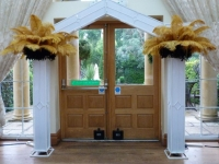 art decor archway with feathers