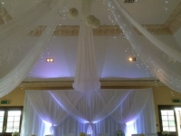 Grecian backdrop with ceiling drapes
