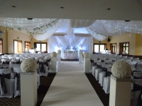 grecian backdrop with ceiling drape rose ball columns