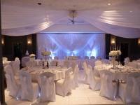 Banquet suite full set up with ceiling drapes