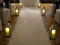 ceremony with silver lanterns and dancing flame candles